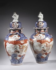 A pair of Imari jars and covers