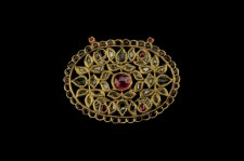 An oval pendant inset with rubies and diamonds North India 19th Century
